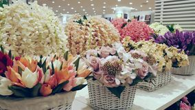 Colorful artificial flowers decoration. stock footage