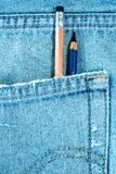 Pencil in the pocket of blue jean. Different type of pencils in the pocket of denim blue jean Royalty Free Stock Image