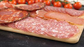 Different type of salami. On wooden board. Dolly footage stock video footage