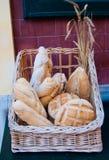 Wicker basket full of bread loaves stock photo