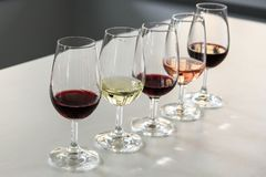 Different type of wines ready for wine tasting. Red wine, white wine, rose wine royalty free stock images