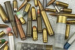 Different types of ammunition. Bullets of different calibers and types. The right to own a gun. Sales of weapons and ammunition stock photography