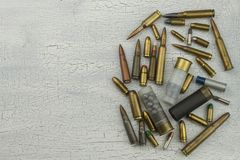 Different types of ammunition. Bullets of different calibers and types. The right to own a gun. Stock Photo