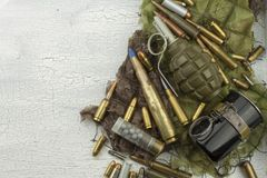 Different types of ammunition on a camouflage background. Preparing for war. Possession of weapons royalty free stock photo