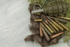 Different types of ammunition on a camouflage background. Preparing for war Royalty Free Stock Photography