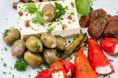 Different types of Antipasto on a plate Royalty Free Stock Photos