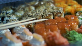 Different Types of Appetizing Sushi in Plastic Containers stock video footage