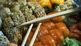 Different Types of Appetizing Sushi in Plastic Containers stock footage