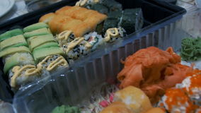 Different Types of Appetizing Sushi in Plastic Containers stock video