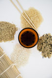 Different types of asian rice. Chopsticks, straw matt for rolls, soy sauce Royalty Free Stock Photo