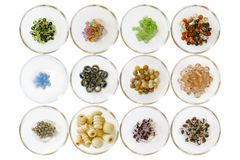 Different types of beads; on white in small glass bowls stock photography