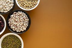 Different types of beans in bowls royalty free stock images
