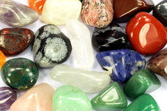Different types birth stones as background. Royalty Free Stock Photography