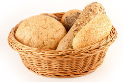 Different types of bread in a basket. Basket of various fresh baked bread Royalty Free Stock Images