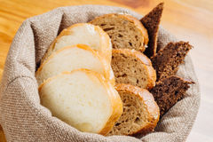 Different types of bread in the basket on the table Royalty Free Stock Image