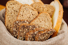 Different types of bread in the basket on the table Royalty Free Stock Photo