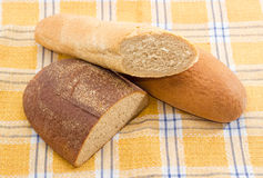 Different types of bread on a checkered tablecloth Stock Photo