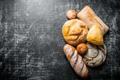 Different types of bread. On dark rustic background stock photography