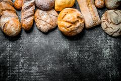 Different types of bread. On dark rustic background royalty free stock photo