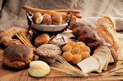 Different types of bread on a jute canvas royalty free stock image