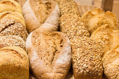 Different types of bread. On the shelves Stock Photos