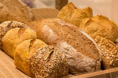 Different types of bread. On the shelves Royalty Free Stock Photography
