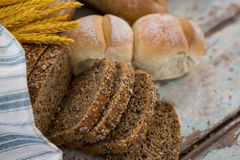 Different types of bread with wheat grains Stock Photo
