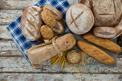Different types of bread with wheat grains and oats Royalty Free Stock Image
