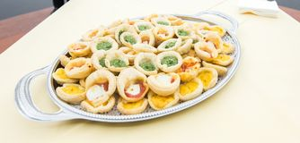 Different types of buns with mozzarella, pesto and eggs on a tray Stock Image