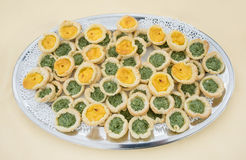 Different types of buns with pesto and eggs on a tray Royalty Free Stock Photo