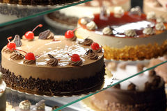 Different types of cakes in pastry shop glass display Royalty Free Stock Photography