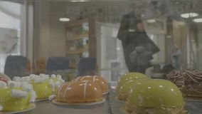 Different types of cakes in pastry shop glass display. View from the window with cakes, came a host of confectionery stock footage