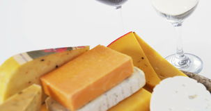 Different types of cheese. Against white background stock video