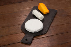 Different types of cheese. Close-up of different types of cheese on chopping board Royalty Free Stock Photo