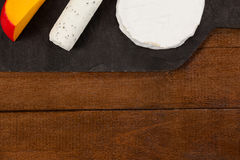 Different types of cheese. Close-up of different types of cheese on chopping board Royalty Free Stock Photos
