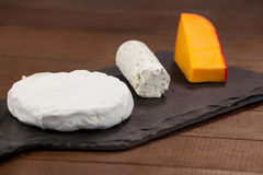 Different types of cheese. Close-up of different types of cheese on chopping board Royalty Free Stock Image