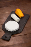Different types of cheese. Close-up of different types of cheese on chopping board Stock Photo