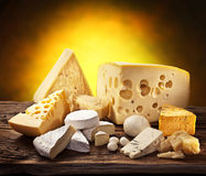 Different types of cheese on old wood. Royalty Free Stock Image