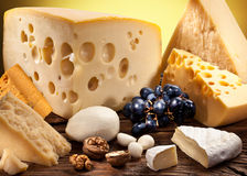 Different types of cheese on old wooden. Royalty Free Stock Photography