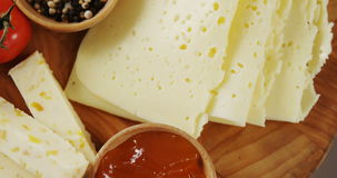 Different types of cheese, tomatoes and bowl of jam and spices stock video footage