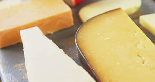 Different types of cheese. On tray stock footage