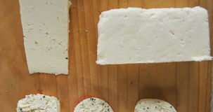 Different types of cheese. On wooden board stock video