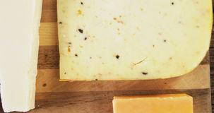 Different types of cheese. On wooden board stock footage