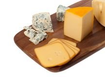 Different types of cheese on wooden kitchen board Stock Photo
