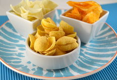 Different types of chips on a table Stock Photography