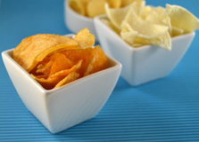 Different types of chips on a table Stock Images
