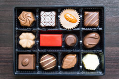 Different types of chocolate candies on a wooden background Stock Photography