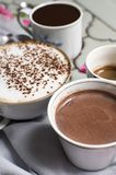 Different types of coffee. Four cups of hot aromatic coffee and chocolate. Belgian hot chocolate, espresso, espresso macchiato and royalty free stock images