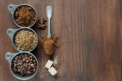 Different types of coffee on a wooden background Royalty Free Stock Photo