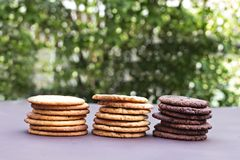 Stacks of chocolate cookies, cookies with chocolate drops, cookies with oatmeal. Different types of cookies. Stacks of chocolate cookies, cookies with chocolate Stock Photos